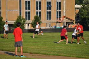 Camp participants play soccer under a backdrop of campus construction.  (photo by Amy Beare)
