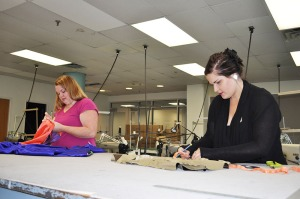 Kent State senior fashion  students Via Stacey and Eliza Svon work on commissioned garments in Rockwell Hall.