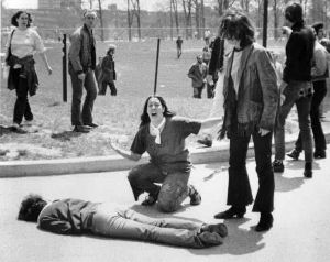 John Filo's photo of the May 4, 1970 massacre of four students won the Pulitzer Prize. The pole over the central subject's (Mary Ann Vecchio's) head is digitally removed from most reproductions of this photo. (Photo: © John Filo)