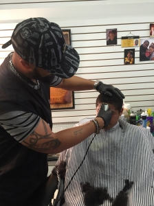"Bankston cuts an ""even-steven"" for a young client at Leander's Barber Shop. Bankston says the cut is ""mom's favorite."" (photo by Kristen Hamilton)"